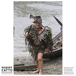 Maori warriors arrive in waka (canoes) at the premiere of the film River Queen in Wanganui, New Zealand.<br />