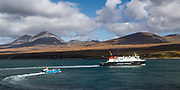 MV Finlaggan and the Jura ferry depart Port Askaig on the Sound of Islay