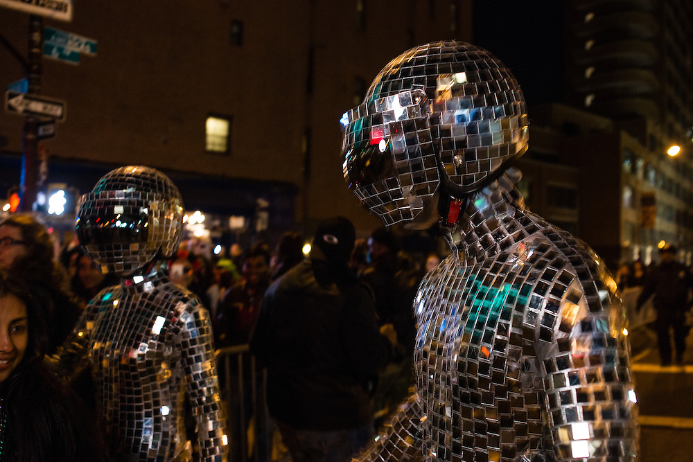 New York, NY - 31 October 2016. Two men in futuristic space man suits covered with hundreds of small reflective tiles.