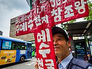 09 JUNE 2018 - SEOUL, SOUTH KOREA: A South Korean Christian at a pro-American rally in downtown Seoul. Christianity is the second largest religion in South Korea. Participants said they wanted to thank the US for supporting South Korea and they hope the US will continue to support South Korea. Many were also opposed to ongoing negotiations with North Korea because they don't think Kim Jong-un can be trusted to denuclearize or to not attack South Korea.   PHOTO BY JACK KURTZ