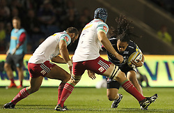 Sale Sharks' TJ Ioane is tackled by Harlequins' Jamie Roberts (left), during the Aviva Premiership match at the AJ Bell Stadium, Salford.
