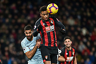 AFC Bournemouth Midfielder, Junior Stanislas (19) wins a header  during the Premier League match between Bournemouth and Chelsea at the Vitality Stadium, Bournemouth, England on 30 January 2019.