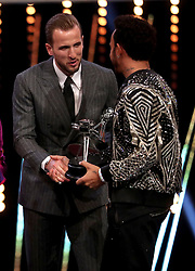 Third placed Harry Kane (left) and second placed Lewis Hamilton shake hands during the BBC Sports Personality of the Year award during the BBC Sports Personality of the Year 2018 at Birmingham Genting Arena.