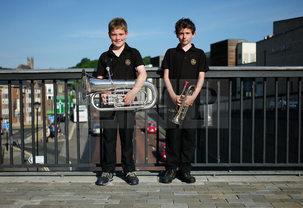 "© Licensed to London News Pictures. 13/07/2013<br /> <br /> Durham City, England, United Kingdom<br /> <br /> Owen Brown, 12 and Josh Fletcher, 11 both from Durham were playing with this focal colliery band.<br /> <br /> The Durham Miners' Gala is a large annual gathering held each year in the city of Durham. It is associated with the coal mining heritage of the Durham Coalfield, which stretched throughout the traditional County of Durham, and also gives voice to miners' trade unionism. <br /> <br /> Locally called ""The Big Meeting"" or ""Durham Big Meeting"" it consists of banners, each typically accompanied by a brass band, which are marched to the old Racecourse, where political speeches are delivered. In the afternoon a Miners' service is held in Durham Cathedral <br /> <br /> Photo credit : Ian Forsyth/LNP"