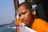 """young monk on river ferry in Bangkok, Thailand, 2002<br /> Available as Fine Art Print in the following sizes:<br /> 08""""x12""""US$   100.00<br /> 10""""x15""""US$ 150.00<br /> 12""""x18""""US$ 200.00<br /> 16""""x24""""US$ 300.00<br /> 20""""x30""""US$ 500.00"""
