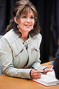 """23 NOVEMBER 2010 - PHOENIX, AZ: SARAH PALIN at a Barnes and Noble store in Phoenix Tuesday. Palin signed copies of her new book, """"America by Heart"""" at the store in north Phoenix Tuesday night, Nov. 23. It was the kick off of her book tour to support America by Heart. Palin is frequently mentioned as a possible Republican candidate for US President in 2012.   Photo by Jack Kurtz"""