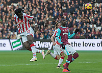 Football - 2016 / 2017 Premier League - West Ham United vs. Stoke City<br /> <br /> Wilfred Bony of Stoke City with headed attempt at goal at The London Stadium.<br /> <br /> COLORSPORT/DANIEL BEARHAM