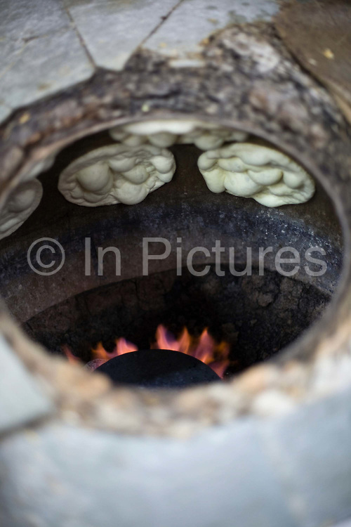 L M Rahman preparing and cooking fresh naan bread in the tandoor oven at Karim's Restaurant, Delhi, India<br /> Karim's is a Delhi landmark was started by Haji Karimuddin who decided to open a restuarant catering to people coming to Delhi for the Coronation Durbar in 1911