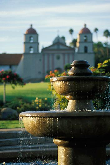 Fountain and historic Mission church in Santa Barbara, central California coast, USA