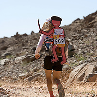 27 March 2007:  #509 Lia Farley of USA runs across the gorge of El Maharch during third stage of the 22nd Marathon des Sables between jebel El Oftal and jebel Zireg (20.07 miles). Lia is a member of Team Good for Kids, and runs to raise funds for this organization. The Marathon des Sables is a 6 days and 151 miles endurance race with food self sufficiency across the Sahara Desert in Morocco. Each participant must carry his, or her, own backpack containing food, sleeping gear and other material.