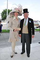 LORD FELLOWES and his with LADY EMMA KITCHENER-FELLOWES at the Investec Derby at Epsom Racecourse, Epsom Downs, Surrey on 4th June 2011.