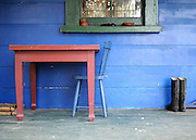 NEW ZEALAND   A table and chair  with wellington boots at a farmhouse on the North Island  30/12/2009. STEPHEN SIMPSON...