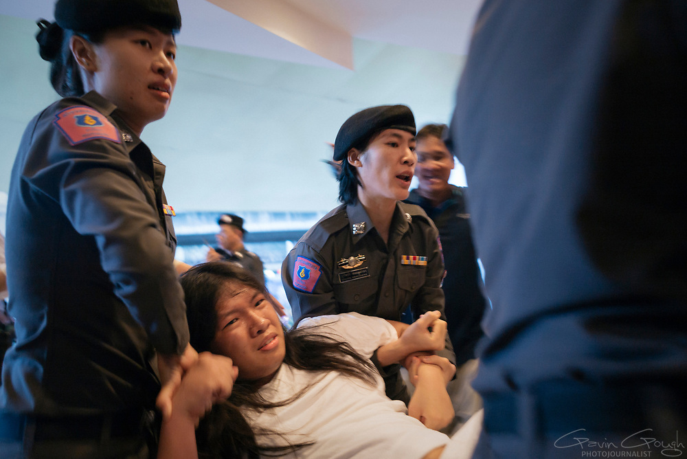 A student demonstrator is arrested and carried away by female police officers following a protest in Bangkok, Thailand.