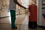 A prisoner posting a letter in the wing post box on D wing, HMP Kingston. Portsmouth, United Kingdom. Kingston prison is a category C prison holding indeterminate sentenced prisoners.