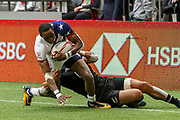 VANCOUVER, BC - MARCH 11: Perry Baker (#11) of USA brought down by New Zealand tackler during Game # 31- New Zealand vs United States Cup QF3 match at the Canada Sevens held March 10-11, 2018 in BC Place Stadium in Vancouver, BC. (Photo by Allan Hamilton/Icon Sportswire)
