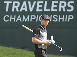 June 22, 2018 - Cromwell, CT, USA - Bryson Dechambeau checks his scorebook on the 9th green as he looks over his birdie putt during the second round of the Travelers Championship at TPC River Highlands in Cromwell, Conn., on Friday, June 22, 2018. (Credit Image: © John Woike/TNS via ZUMA Wire)