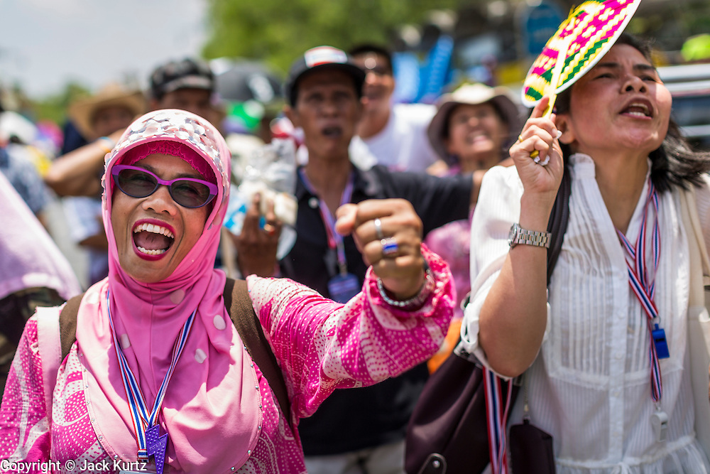 """09 MAY 2014 - BANGKOK, THAILAND: Thai anti-government protestors cheer for Suthep Thaugsuban as he walks past Government House in Bangkok. Thousands of Thai anti-government protestors took to the streets of Bangkok Friday to start their """"final push"""" to bring the popularly elected of government of Yingluck Shinawatra. Yingluck has already been forced out by a recent court ruling that forced her to resign and she is facing indictment by the National Anti Corruption Commission of Thailand for alleged improprieties related to a government rice price support scheme. The protestors Friday were marching to demand that she not be allowed to return to politics. The courts have not banned her party, Pheu Thai, which has formed an interim caretaker government to govern until elections expected in July, 2014. Suthep Thaugsuban, secretary-general of the People's Democratic Reform Committee (PDRC),  said the president of the Supreme Court and the new senate speaker, who would be selected Friday, should set up an """"interim people's government and legislative assembly."""" He went onto say that if they didn't, he would.     PHOTO BY JACK KURTZ"""