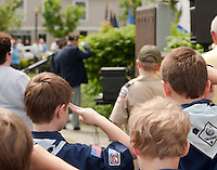 Members of Laconia Scout Pack 68 salute during the Memorial Day festivities at Veteran's Square in Laconia Sunday morning.  (Karen Bobotas/for the Laconia Daily Sun)Memorial Day parade and services in Laconia, New Hampshire  May 30, 2011.  Karen Bobotas/for the Laconia Daily Sun