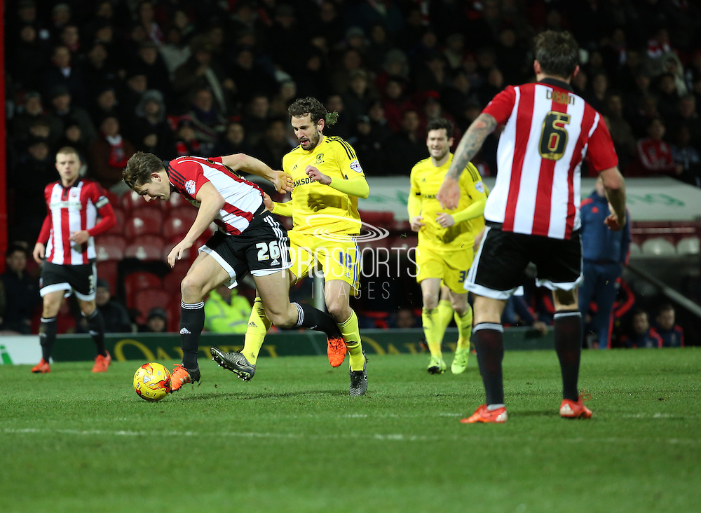 Middlesbrough striker Christian Stuani fouling Brentford defender James Tarkowski during the Sky Bet Championship match between Brentford and Middlesbrough at Griffin Park, London, England on 12 January 2016. Photo by Matthew Redman.