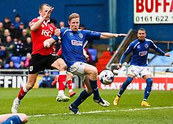 Bristol City's Aaron Wilbraham challenges Oldham Athletic's Liam Kelly  - Photo mandatory by-line: Matt McNulty/JMP - Mobile: 07966 386802 - 03/04/2015 - SPORT - Football - Oldham - Boundary Park - Oldham Athletic v Bristol City - Sky Bet League One