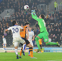 Hull City's Eldin Jakupovic claims a high ball under pressure from Leicester City's Shinji Okazaki<br /> <br /> Photographer Chris Vaughan/CameraSport<br /> <br /> Football - Capital One Cup Round 4 - Hull City v Leicester City - Tuesday 27th October 2015 - Kingston Communications Stadium - Hull<br />  <br /> © CameraSport - 43 Linden Ave. Countesthorpe. Leicester. England. LE8 5PG - Tel: +44 (0) 116 277 4147 - admin@camerasport.com - www.camerasport.com