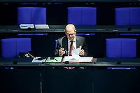 08 DEC 2020, BERLIN/GERMANY:<br /> Olaf Scholz, MdB, SPD, Bundesfinanzminister, schreibt in seine Unterlagen, Haushaltsdebatte, Plenum, Reichstagsgebaeude, Deuscher Bundestag<br /> IMAGE: 20201208-02-053<br /> KEYWORDS: lesen, Akten, liest, schreiben