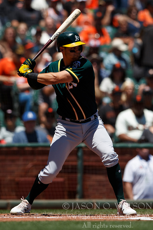SAN FRANCISCO, CA - JULY 15: Chad Pinder #18 of the Oakland Athletics at bat against the San Francisco Giants during the first inning at AT&T Park on July 15, 2018 in San Francisco, California. The Oakland Athletics defeated the San Francisco Giants 6-2. (Photo by Jason O. Watson/Getty Images) *** Local Caption *** Chad Pinder
