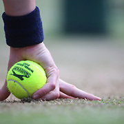 LONDON, ENGLAND - JULY 14: A ball boy holds a ball as he crouches near the net ready to retrieve another ball on Center Court during the Wimbledon Lawn Tennis Championships at the All England Lawn Tennis and Croquet Club at Wimbledon on July 14, 2017 in London, England. (Photo by Tim Clayton/Corbis via Getty Images)