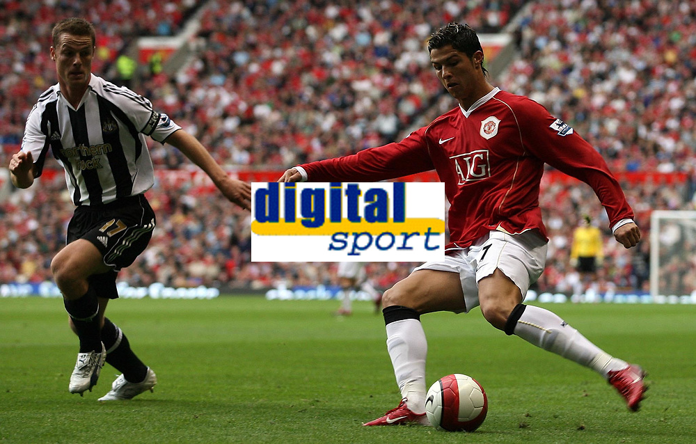 Photo: Paul Thomas.<br /> Manchester United v Newcastle United. The Barclays Premiership. 01/10/2006.<br /> <br /> Scott Parker (L) can't stop Cristiano Ronaldo of Man Utd from crossing the ball.