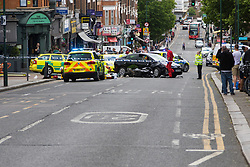 Kensal Rise, London, June 11th 2017. A motorcyclist is injured in a collision with a car on Chamberlayne Road, Kensal Rise, London. The accident has caused police to close Chamberlayne Road to all traffic. The extent of the rider's injuries is not known, but London Ambulance Service paramedics and Air ambulance Doctors are attending.