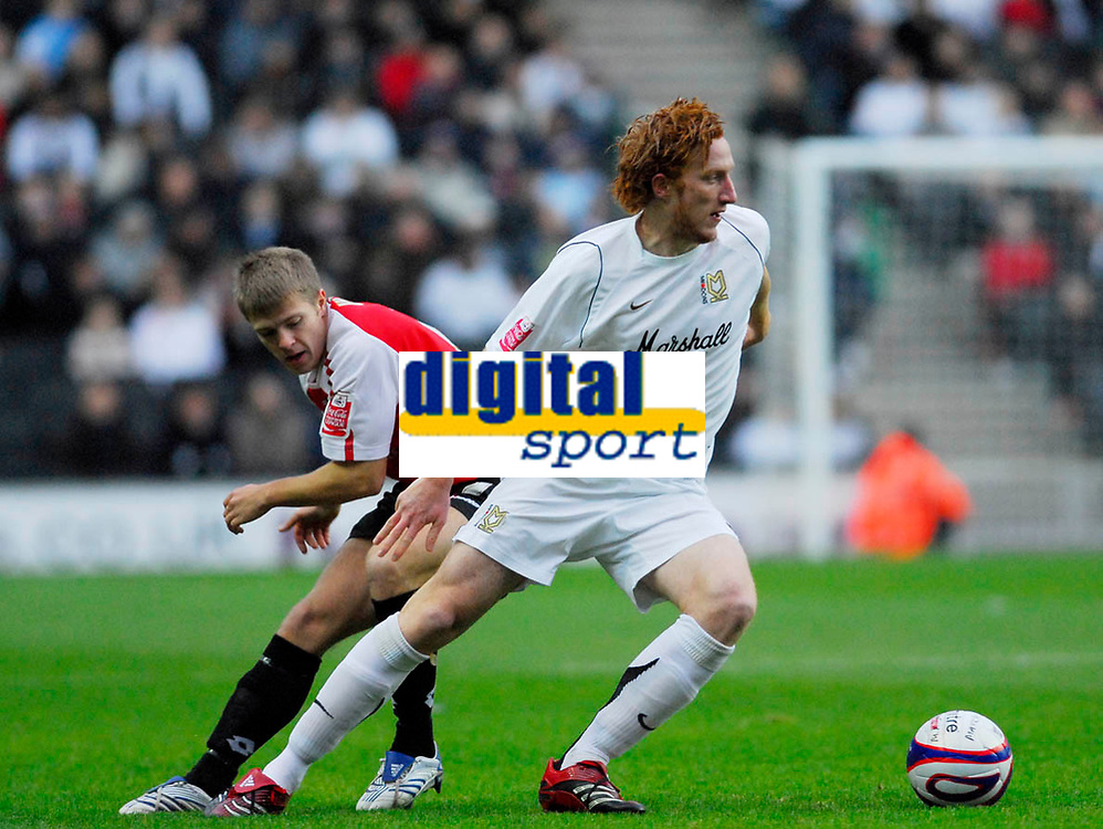 Photo: Leigh Quinnell/Sportsbeat Images.<br /> Milton Keynes Dons v Chesterfield. Coca Cola League 2. 24/11/2007. MK Dons Dean Lewington gets away from Chesterfields  Jamie Ward.