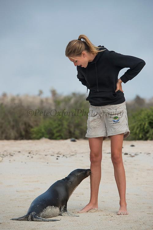 Model With Galapagos Sea Lion (Zalophus wollebaeki)<br /> KT 013 Florencia Ceide<br /> Santa Fe<br /> GALAPAGOS<br /> Ecuador<br /> South America<br /> Endemic