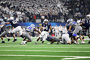 Penn State Nittany Lions running back Journey Brown (4) runs through as defensive back Sanchez Blake Jr. (41) tries to make the tackle during the game of the NCAA Cotton Bowl Classic football game, Saturday, Dec. 28, 2019, in Arlington, Texas. Penn State defeated Memphis 53-39. (Mario Terrana/Image of Sport)