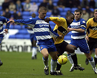 Picture: Henry Browne.<br />Date: 08/11/2003.<br />Reading v Wigan Athletic Nationwide Division One.<br /><br />Reading's Ivar Ingimarsson holds off Wigan's Nathan Ellington