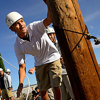 110813       Adron Gardner<br /> <br /> Quenton James reaches for a pillar while balancing on the Mohawk walk wire as Cash Adam Beach, right, watches as a spotter in Rehoboth Friday.