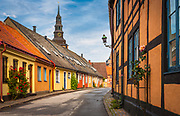 """Korsvirkeshus"" type house in central Ystad in the southern province of Skåne in Sweden<br /> .....<br /> Ystad is a town, and the seat of Ystad Municipality, Skåne County, Sweden, with 18,350 inhabitants in 2010. The settlement dates back to the 11th century and the town has become a busy ferryport, local administrative centre and tourist attraction. It is associated with the fictional detective Kurt Wallander whose stories, by Henning Mankell, are set primarily in Ystad and nearby communities. In 1285, the town's name was written Ystath. Its original meaning is not fully understood, but the ""y"" is probably related to an old word for the yew tree, while -stad is town, or place. In Danish times before 1658 the spelling was Ysted."