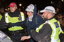 London, November 5th 2016. Anti-capitalists and anarchists participate in the Million Mask March, an annual event that happens on November 5th each year in cities across the world, as part of a protest against the establishment. Many of the protesters wear Guy Fawkes masks, often associated with the internet activism group Anonymous. PICTURED: A man is arrested outside the gates of Downing Street.