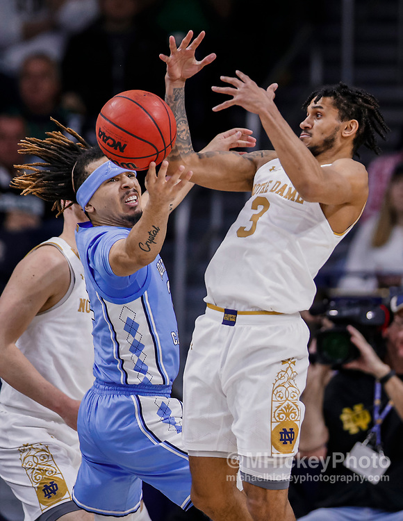 SOUTH BEND, IN - FEBRUARY 17: Cole Anthony #2 of the North Carolina Tar Heels and Prentiss Hubb #3 of the Notre Dame Fighting Irish reach for the ball during the game at Purcell Pavilion on February 17, 2020 in South Bend, Indiana. (Photo by Michael Hickey/Getty Images) *** Local Caption *** Cole Anthony; Prentiss Hubb