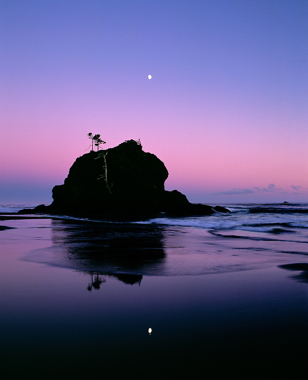 The moon hangs above a seastack at Second Beach, Olympic NP, Washington, a World Heritage Site.