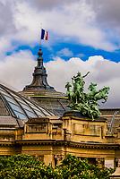 L'Immortalite Devancent le Temps quadriga statue atop the Grand Palais, Paris, France.