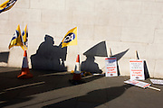 Anonymous staff silhouetted from the Public and Commercial Services Union PCS union outside National Gallery, London