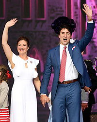 Prime Minister Justin Trudeau and his wife Sophie Gregoire Trudeau wave at the end of the Canada Day noon hour show on Parliament Hill in Ottawa on Saturday, July 1, 2017. Photo by Justin Tang/CP/ABACAPRESS.COM