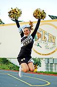 500px Photo ID: 4376899 - cheerleader performing a peter pan jump