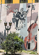 A tango mural featuring dancing couples, cupids, and a bass violin decorates a wall next to a street lamp in San Telmo barrio, the heart of old Buenos Aires, Argentina, South America. The double bass (also known as the contrabass, string bass, upright bass, bull fiddle, bass fiddle, bass violin, or simply bass) is the largest and lowest pitched bowed string instrument used in the modern symphony orchestra.