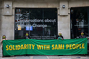 Activists from the Forest Rebellion, known as Skogsupproret in Sweden, protest behind a banner outside the premises of the Timber Trade Federation at the Building Centre on 24th July 2021 in London, United Kingdom. The activists were protesting against the clearcutting of natural forests in Sweden and the social and environmental impacts of timber imports from Swedish logging companies with UK subsidiaries belonging to the Timber Trade Federation, whilst also standing in solidarity with the indigenous Sami people of northern Scandinavia and demanding that their rights be respected. Sweden is the largest lumber supplier to the UK.