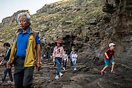 Jeju Island, South Korea - September 15, 2019:  Visitors explore the Yongmeori Coast, a UNESCO World Heritage Site on Jeju Island, South Korea.