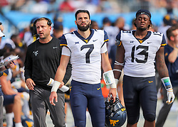 Sep 1, 2018; Charlotte, NC, USA; West Virginia Mountaineers quarterback Will Grier (7) walks down the sidelines against the Tennessee Volunteers after the first quarter at Bank of America Stadium. Mandatory Credit: Ben Queen-USA TODAY Sports