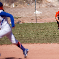 042313       Cable Hoover<br /> <br /> Gallup Bengal Mia Salazar (16) chases down a grounder as the Los Lunas Tigers round the bases Tuesday at Gallup High School.