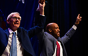 Tony Evers and Mandela Barnes cheer to the crowd during the Election Night watch party at the Orpheum Theater in Madison, Wisconsin, Wednesday, Nov. 7, 2018.