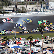 NASCAR Sprint Cup Series drivers Michael Waltrip (15), Andy Lally (71), Joe Nemechek (87) Greg Biffle (16) and David Reutimann (00) are involved in a multi car crash during the Daytona 500 at Daytona International Speedway on February 20, 2011 in Daytona Beach, Florida. (AP Photo/Alex Menendez)
